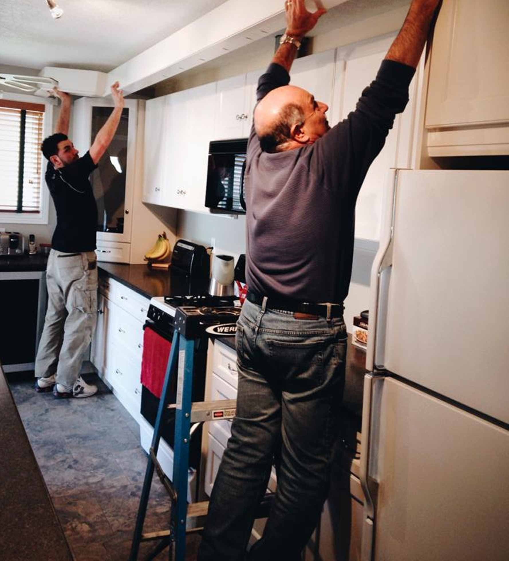 People installing cabinets